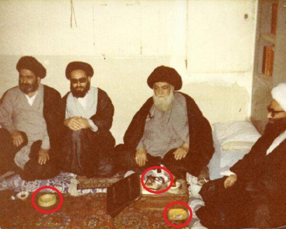 Look at his accursed face. TWO packs of Rothmans  and EACH of them has an ashtray! Scholars of the 'Ahl Al-Bayt school' after all ....