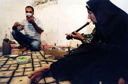 old_woman_smoking_opium